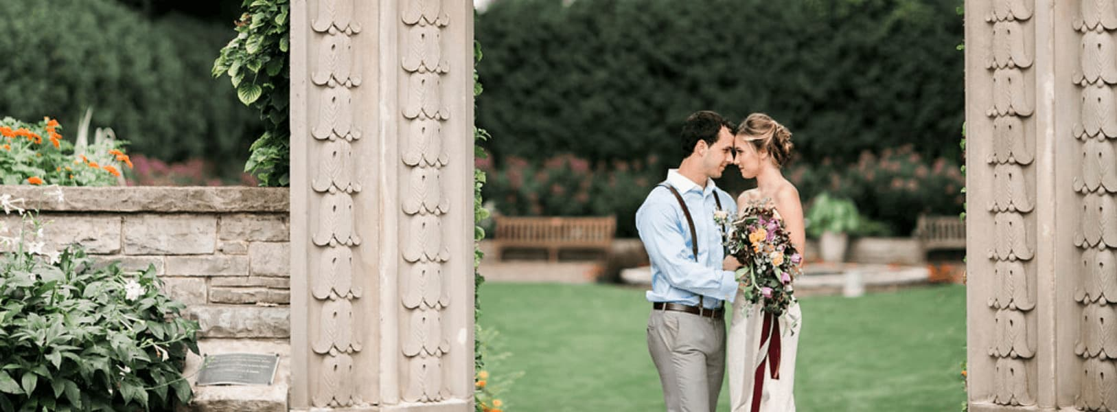 Newly married couple embraces in the Sunken Garden